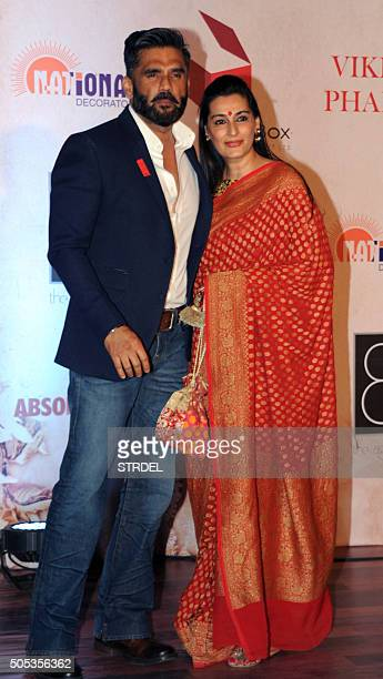 Indian Bollywood actor Suniel Shetty and his wife pose for a photograph during the Vikram Phadnis fashion show in Mumbai on late January 16 2016 AFP...