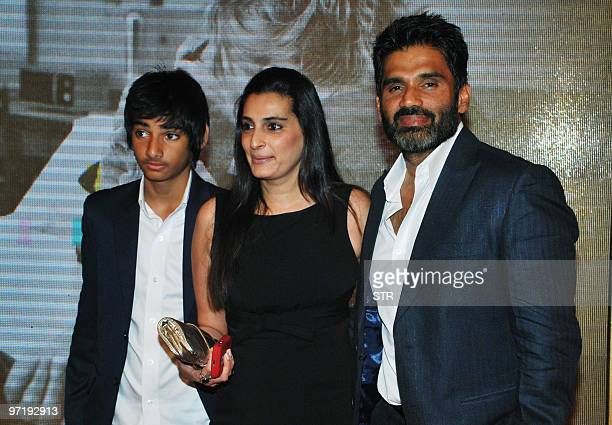 Indian Bollywood actor Sunil Shetty arrives with his family at a soiree held by Head of Reliance Group of Industry Head Anil Dhirubhai Ambani and his...