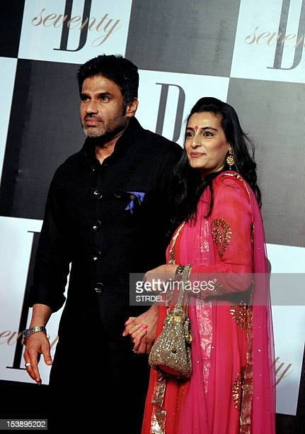 Indian Bollywood actor Sunil Shetty poses with his wife Mana as they attend the 70th Birthday celebrations of Bollywood Actor Amitabh Bachchan in...