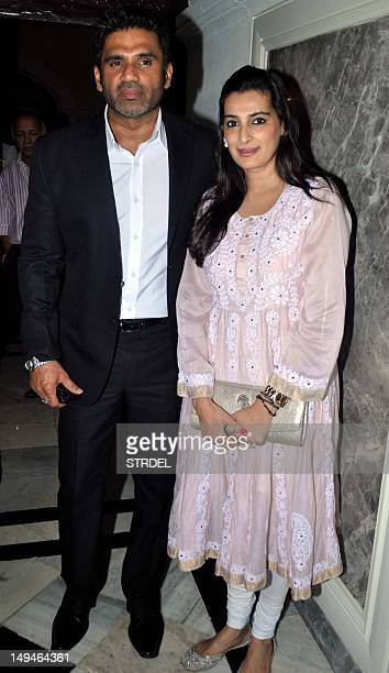 Indian Bollywood actor Sunil Shetty with wife Mana Shetty attend a press conference on Hepatitis B in Mumbai on July 28 2012 AFP PHOTO/STR