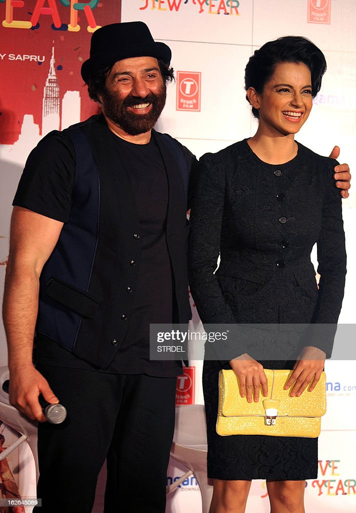 Indian Bollywood actor Sunny Deol (L) and actress Kangana Ranaut attend a media event for the forthcoming Hindi Film 'I Love New Year' in Mumbai on February 25, 2013.