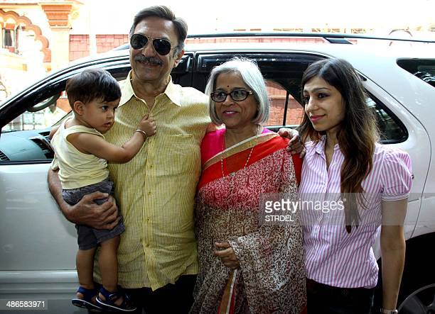 Indian Bollywood actor Suresh Oberoi poses for a photograph with his wife daughter and grandson during voting at a polling station in Mumbai on April...