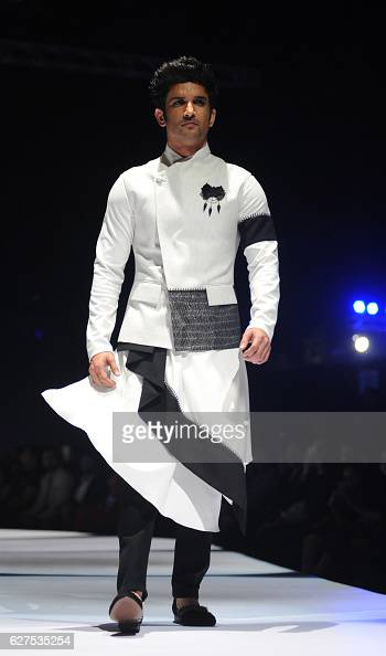 Indian Bollywood actor Sushant Singh Rajput walks the catwalk at the GQ Fashion Nights 2016 menswear fashion show in Mumbai on December 3 2016 / AFP /