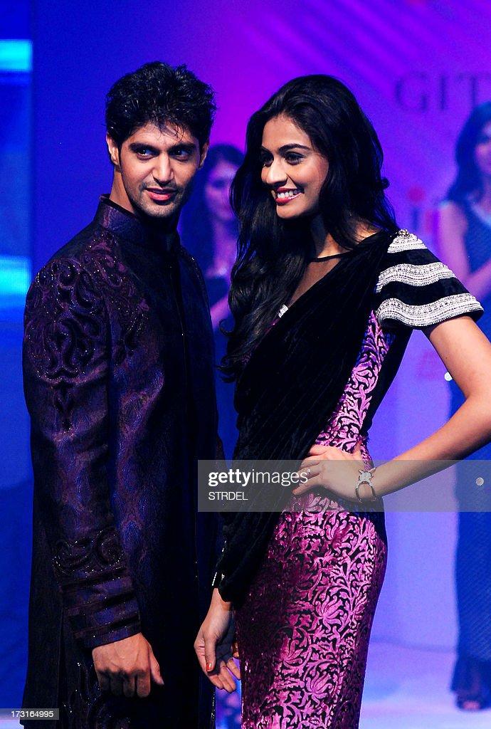 Indian Bollywood actor Tarun Virwani (L) and actress Neha Hinge pose during the Tassel Fashion and Lifestyle Awards 2013 in Mumbai late July 8, 2013.