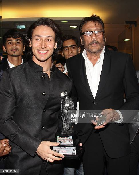 Indian Bollywood actor Tiger Shroff and his father Jacky Shroff attend the 'Dadasahab Phalke Film Foundation Awards 2015' ceremony in Mumbai on April...