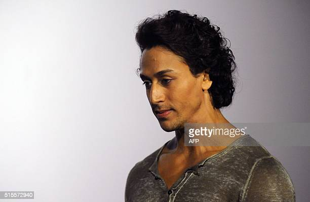 Indian Bollywood actor Tiger Shroff attends the trailer launch of the upcoming Hindi film Baaghi in Mumbai on March 14 2016 / AFP