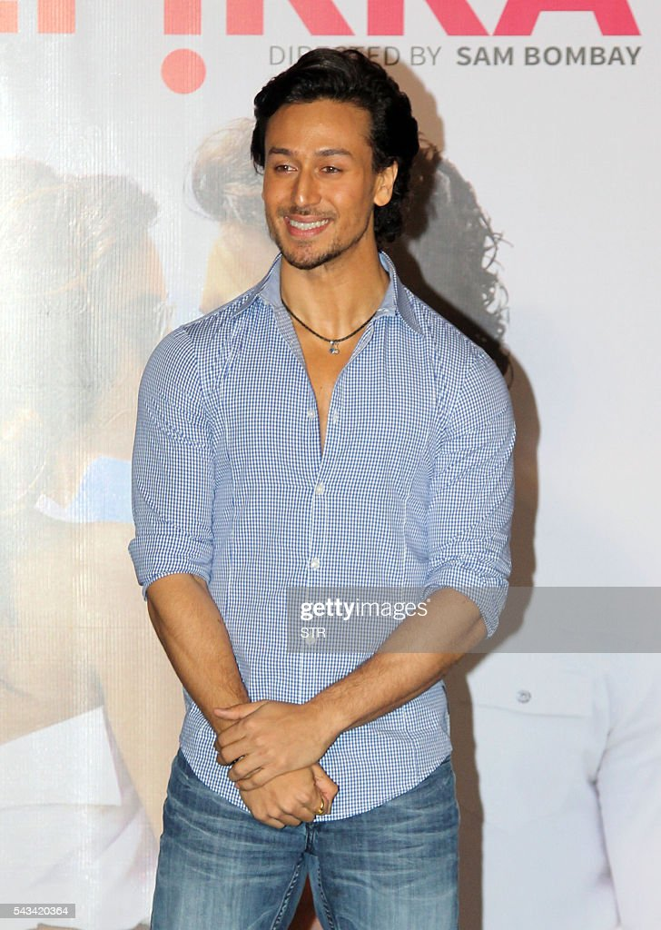 Indian Bollywood actor Tiger Shroff poses during the launch of the single Hindi album 'Befikra' in Mumbai on June 28, 2016. / AFP / STR