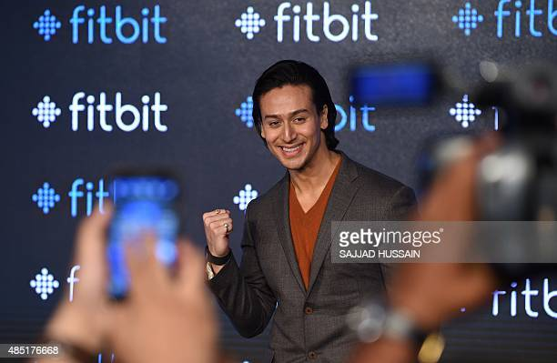 Indian Bollywood actor Tiger Shroff poses for a photograph during a promotional event in New Delhi on August 25 2015 AFP PHOTO / SAJJAD HUSSAIN