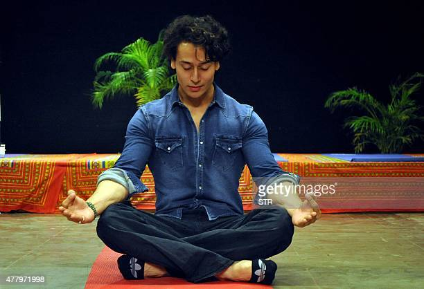 Indian Bollywood actor Tiger Shroff takes part in a yoga session on International Yoga Day in Mumbai on June 21 2015 AFP PHOTO