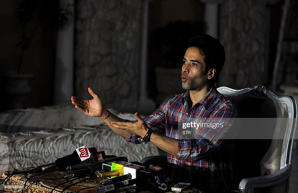 Indian Bollywood actor, Tusshar Kapoor announces that he has became a father of a surrogate baby boy, at his residence in Mumbai on June 27, 2016. / AFP / STR