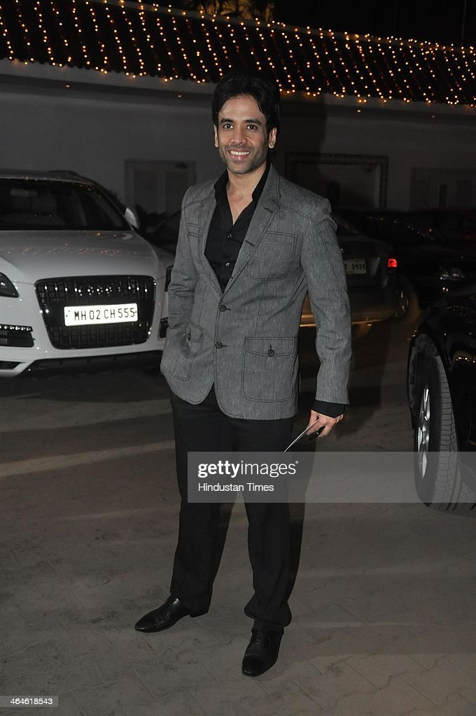 Indian Bollywood actor Tusshar Kapoor during the wedding reception of Bollywood playback singer Raghav Sachar and actor Amita Pathak on January 21, 2014 in Mumbai, India.