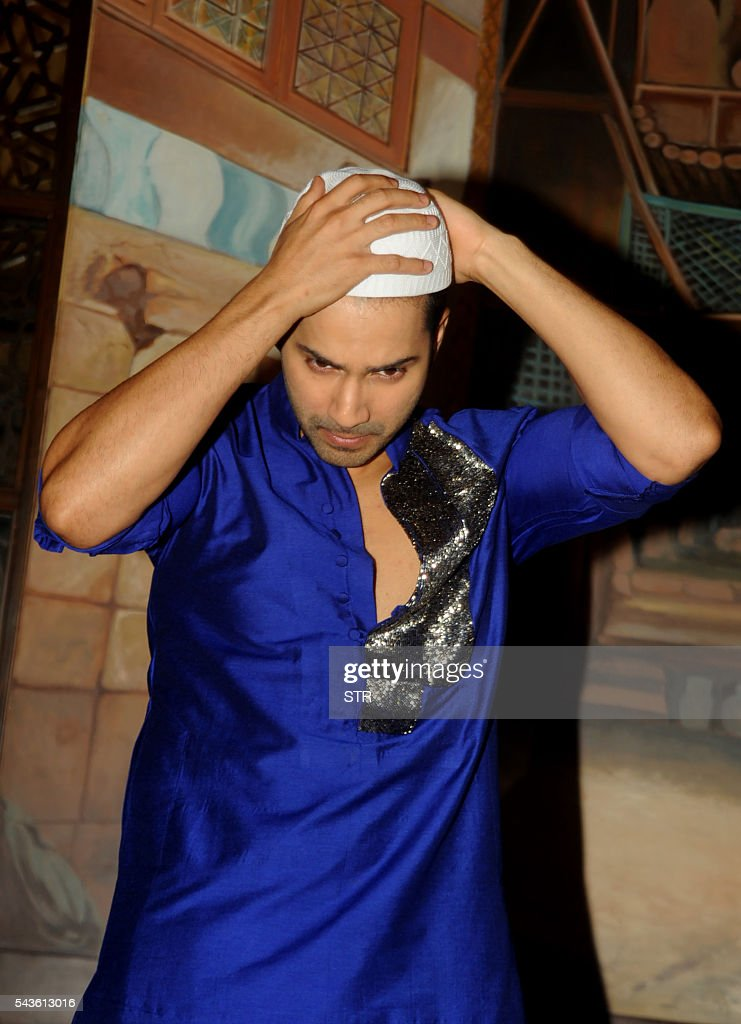 Indian Bollywood actor Varun Dhawan attends the Iftar Party for the promotion of his upcoming Hindi film Dishoom in Mumbai on June 29, 2016. / AFP / STR