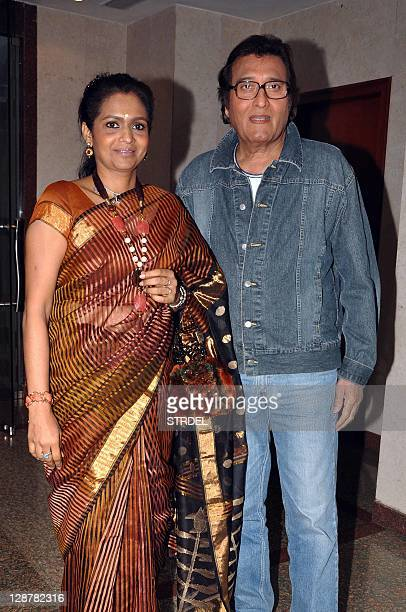 """Indian Bollywood actor Vinod Khanna poses with his wife Kavita during a function promoting the forthcoming Hindi film """"Tell Me O Khuda"""" in Mumbai..."""