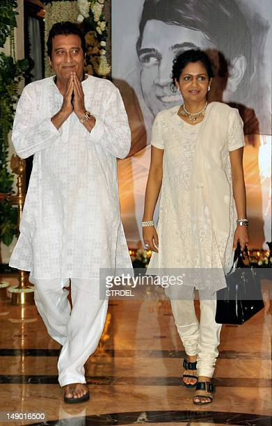 Indian Bollywood actor Vinod Khanna with wife attend a prayer function in memory of late actor Rajesh Khanna in Mumbai on July 21 2012 Khanna...