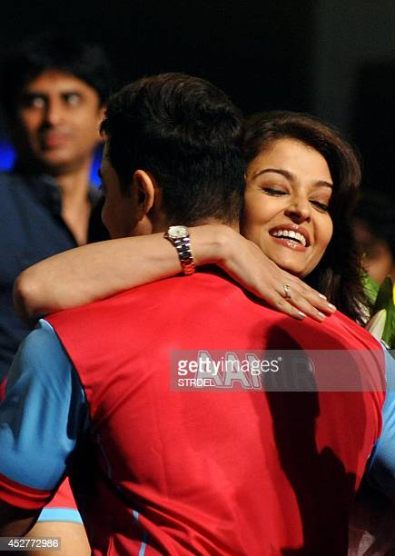 Indian Bollywood actors Aamir Khan and Aishwarya Rai Bachchan greet each other during a professional kabaddi league match in Mumbai on late July 26...