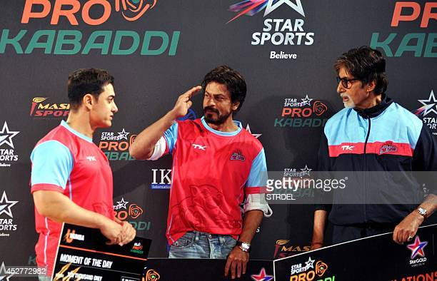 Indian Bollywood actors Aamir Khan Shah Rukh Khan and Amitabh Bachchan talk during a professional kabaddi league match in Mumbai on late July 26 2014...