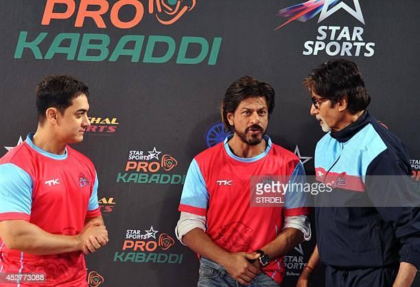 Indian Bollywood actors Aamir Khan Shah Rukh Khan and Amitabh Bachchan talk during a professional kabaddi league match in Mumbai on late July 26 2014...