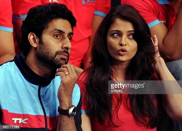 Indian Bollywood actors Abhishek Bachchan and Aishwarya Rai Bachchan look on during a professional kabaddi league match in Mumbai on late July 26...