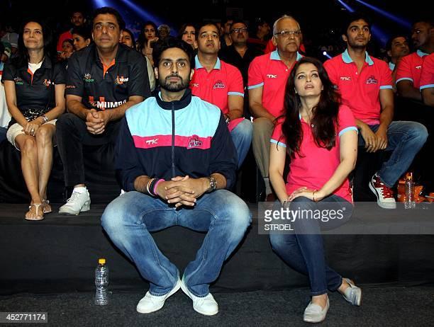 Indian Bollywood actors Abhishek Bachchan and Aishwarya Rai Bachchan look on during a professional kabaddi league match in Mumbai on late July 26...