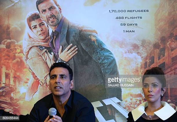 Indian Bollywood actors Akshay Kumar and Nimrat Kaur address a press conference to promote their upcoming movie 'Airlift' in New Delhi on January 18...