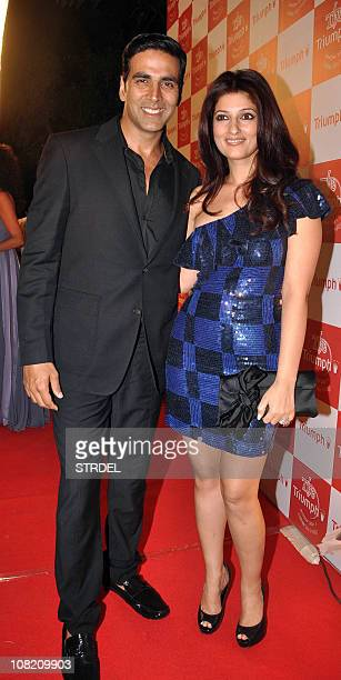Indian Bollywood actors Akshay Kumar and wife Twinkle Khanna arrive at the Triumph Lingerie 2011 fashion shows in Mumbai on January 20 2011 AFP...