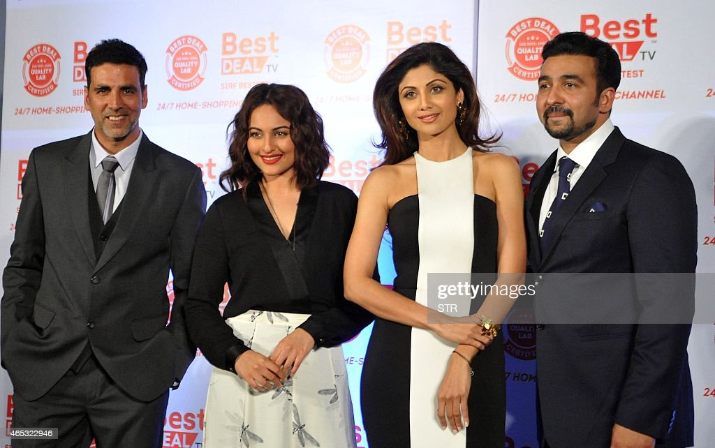 Indian Bollywood actors <a gi-track='captionPersonalityLinkClicked' href=/galleries/search?phrase=Akshay+Kumar&family=editorial&specificpeople=752716 ng-click='$event.stopPropagation()'>Akshay Kumar</a>, <a gi-track='captionPersonalityLinkClicked' href=/galleries/search?phrase=Sonakshi+Sinha&family=editorial&specificpeople=5781347 ng-click='$event.stopPropagation()'>Sonakshi Sinha</a>, <a gi-track='captionPersonalityLinkClicked' href=/galleries/search?phrase=Shilpa+Shetty&family=editorial&specificpeople=565509 ng-click='$event.stopPropagation()'>Shilpa Shetty</a> and her businessman husband <a gi-track='captionPersonalityLinkClicked' href=/galleries/search?phrase=Raj+Kundra&family=editorial&specificpeople=5294666 ng-click='$event.stopPropagation()'>Raj Kundra</a> unveil the first look of Best Deal TV, Indias first celebrity-driven 24/7 Home Shopping Channel in Mumbai on March 5, 2015. AFP PHOTO