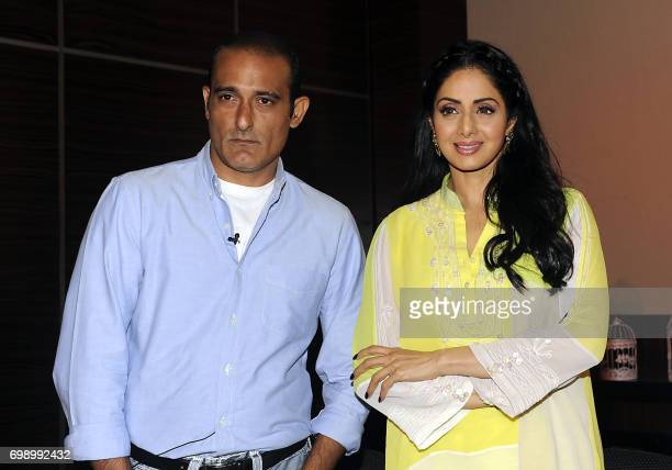 Indian Bollywood actors Akshaye Khanna and Sridevi attend a promotional event for the upcoming thriller Hindi film Mom in Mumbai on June 20 2017 /...