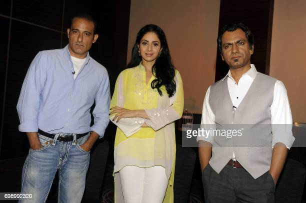 Indian Bollywood actors Akshaye Khanna Sridevi and Nawazuddin Siddiqui attend a promotional event for the upcoming thriller Hindi film Mom in Mumbai...