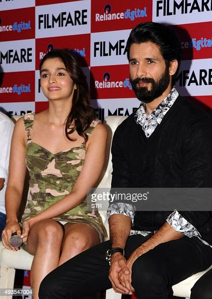 Indian Bollywood actors Alia Bhatt and Shahid Kapoor pose during the launch of the 'FilmFare' magazine cover promoting Hindi film 'Shaandar' directed...