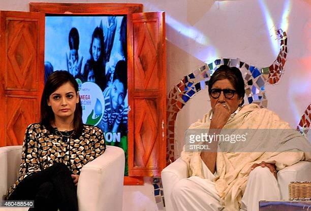 Indian Bollywood actors Amitabh Bachchan and Dia Mirza look on during a 'CLEANATHON' television campaign to promote cleanliness in Mumbai on December...