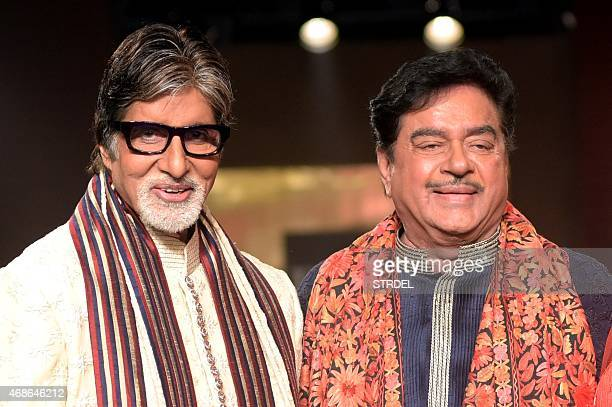Indian Bollywood actors Amitabh Bachchan and Shatrughan Sinha pose for a photograph during a charity fashion show in Mumbai on late April 4 2015 AFP...