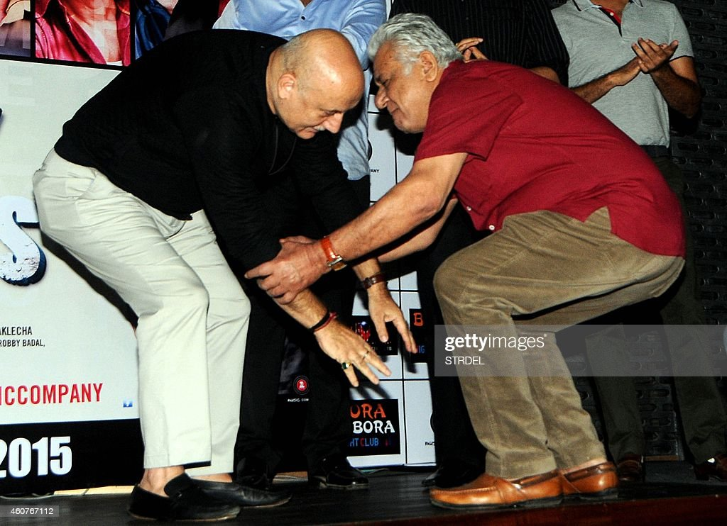 Indian Bollywood actors <a gi-track='captionPersonalityLinkClicked' href=/galleries/search?phrase=Anupam+Kher&family=editorial&specificpeople=767439 ng-click='$event.stopPropagation()'>Anupam Kher</a> (L) and <a gi-track='captionPersonalityLinkClicked' href=/galleries/search?phrase=Om+Puri&family=editorial&specificpeople=1651238 ng-click='$event.stopPropagation()'>Om Puri</a> interact following a traditional greeting during the trailer launch of their upcoming Hindi film Dirty Politics in Mumbai on December 21, 2014.