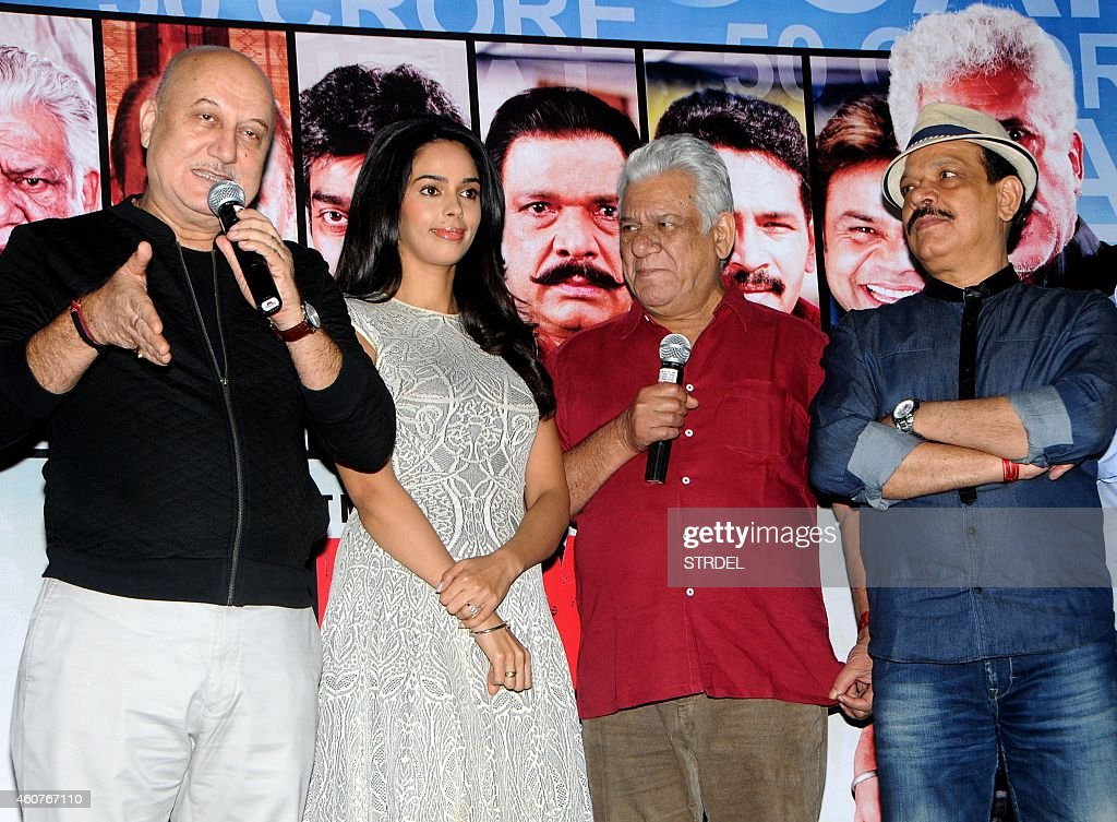 Indian Bollywood actors (L-R) <a gi-track='captionPersonalityLinkClicked' href=/galleries/search?phrase=Anupam+Kher&family=editorial&specificpeople=767439 ng-click='$event.stopPropagation()'>Anupam Kher</a>, <a gi-track='captionPersonalityLinkClicked' href=/galleries/search?phrase=Mallika+Sherawat&family=editorial&specificpeople=233692 ng-click='$event.stopPropagation()'>Mallika Sherawat</a>, <a gi-track='captionPersonalityLinkClicked' href=/galleries/search?phrase=Om+Puri&family=editorial&specificpeople=1651238 ng-click='$event.stopPropagation()'>Om Puri</a> and Govind Namdev during the trailer launch of their upcoming Hindi film Dirty Politics in Mumbai on December 21, 2014.