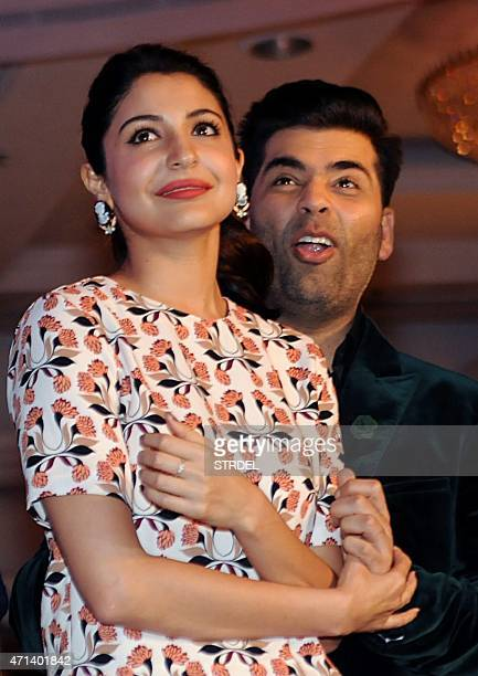 Indian Bollywood actors Anushka Sharma and Karan Johar look on during a promotional event for the forthcoming Hindi film 'Bombay Velvet' directed and...
