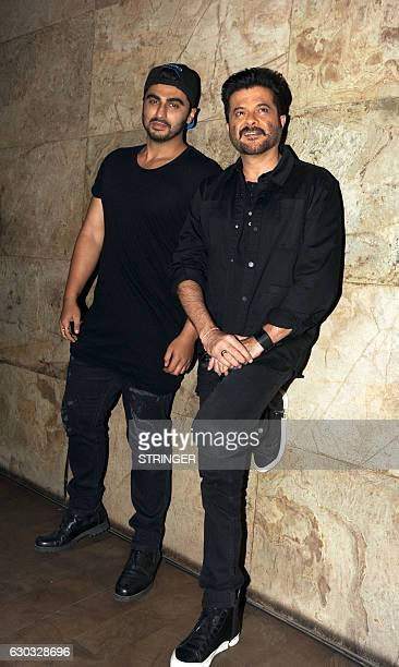 Indian Bollywood actors Arjun Kapoor and Anil Kapoor attend the special screening of the biographical sports drama Hindi film 'Dangal' based on the...