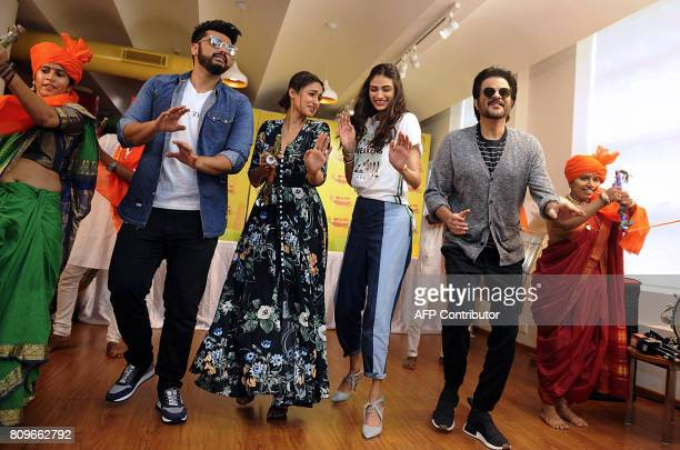 Indian Bollywood actors Arjun Kapoor Ileana DCruz Athiya Shetty and Anil Kapoor dance during the promotional event for the forthcoming Hindi film...