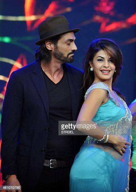 Indian Bollywood actors Arjun Rampal and Jacqueline Fernandez on the set of television show Bigg Boss 8 in Lonavala on January 3 2015 AFP PHOTO/STR