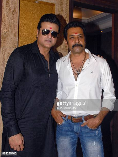Indian Bollywood actors Armaan Kohli and Deepraj Rana pose during the 'mahurat' auspicious inauguration of the production of the upcoming film 'Nie...