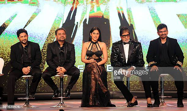 Indian Bollywood actors Arshad Warsi Amitabh Bachchan and actress Regina Cassandra pose during the announcement of the forthcoming Hindi film Aankhen...