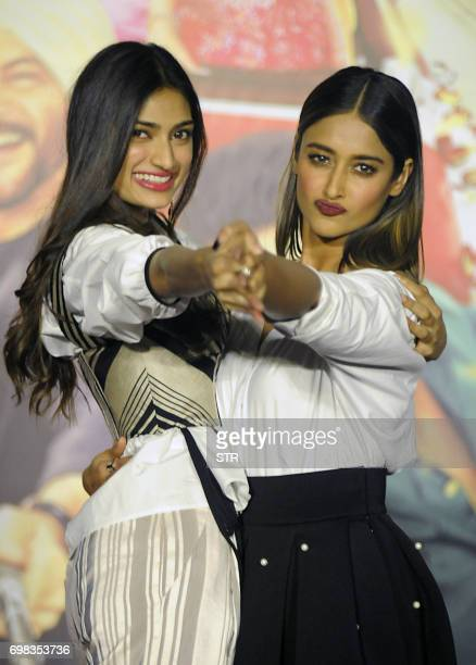 Indian Bollywood actors Athiya Shetty and Ileana DCruz pose for a photograph during a promotional event for the forthcoming Hindi film 'Mubarakan'...