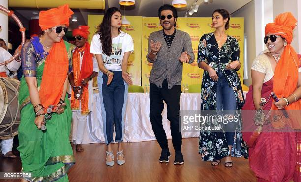 Indian Bollywood actors Athiya Shetty Anil Kapoor and Ileana DCruz dance during a promotional event for forthcoming Hindi film Mubarakan in Mumbai on...