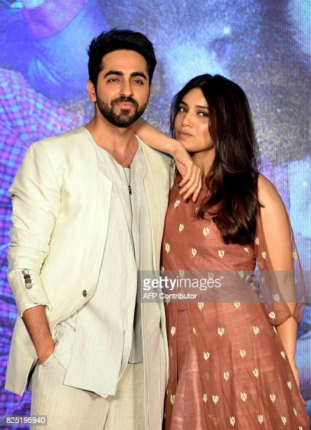 Indian Bollywood actors Bhumi Pednekar and Ayushmann Khurrana pose for a photograph during a promotional event for the forthcoming Hindi film 'Shubh...