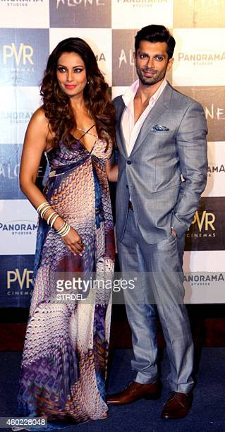 Indian Bollywood actors Bipasha Basu and Karan Singh Grover pose for a photograph during a promotional event for the forthcoming Hindi film 'Alone'...