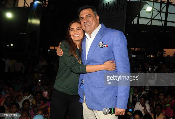 Indian Bollywood actors Esha Gupta and Boman Irani pose for a photograph during a promotional event in Mumbai on November 26 2016 / AFP / STR