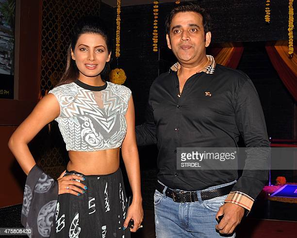 Indian Bollywood actors Geeta Basra and Ravi Kishan pose for a photograph during a promotional event for the forthcoming Hindi film 'Second Hand...