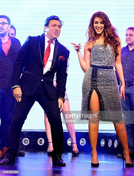 Indian Bollywood actors Govinda and Ileana D'Cruz pose during the music launch of their upcoming Hindi film Happy Ending in Mumbai on October 29 2014...