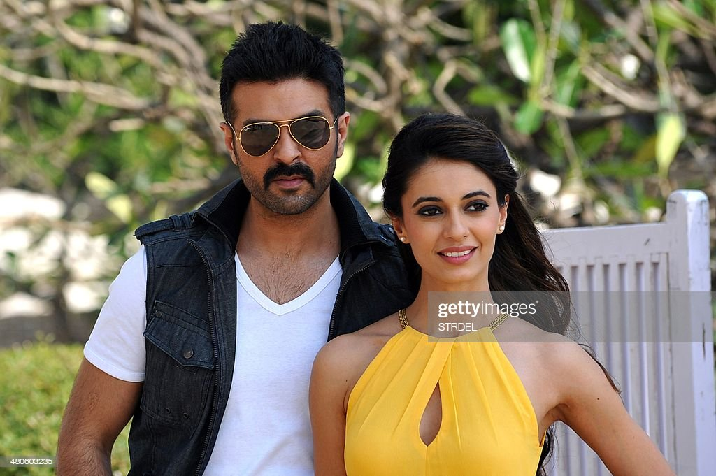 Indian Bollywood actors Harman Baweja (L) and Ayesha Khanna pose for a photograph during a promotional event for the forthcoming Bollywood film 'Dishkiyaaoon' produced by Shilpa Shetty and directed by Sanamjit Singh Talwar in Mumbai on March 25, 2014.