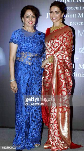 Indian Bollywood actors Hema Malini and Deepika Padukone pose for a photograph during a promotional event in Mumbai on late October 16 2017 / AFP...