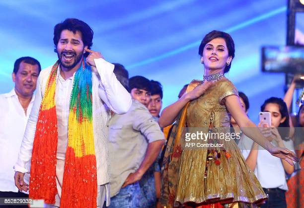 Indian Bollywood actors Jacqueline Fernandez and Varun Dhawan perform to promote their upcoming Hindi film Judwaa 2 in Mumbai on September 23 2017 /...