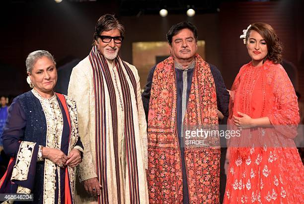 Indian Bollywood actors Jaya Bachchan Amitabh Bachchan Shatrughan Sinha and Sonakshi Sinha pose for a photograph during a charity fashion show in...